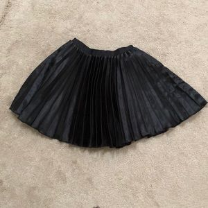 Black accordion mini skirt